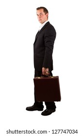 closeup of a businessman holding a briefcase with handcuffs isolated on a white background