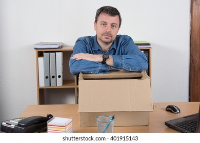 Close-up. businessman holding cardboard box with her things.