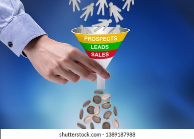 Close-up Of Businessman Holding Funnel Converting Prospects Into Money