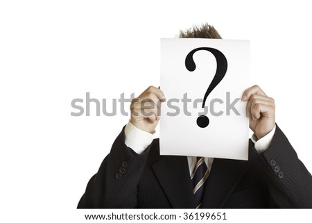 Closeup of businessman holding a sheet with question mark in front of his face.