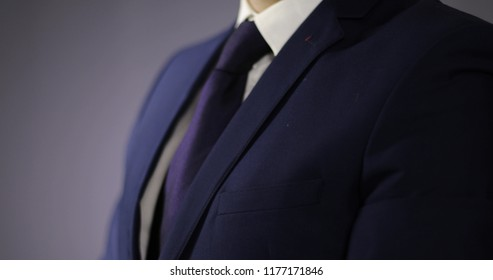 Close-up of a businessman in a jacket and blue tie. Stylish man in a suit.