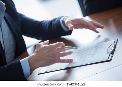 Close-up of businessman keeping hands on contract