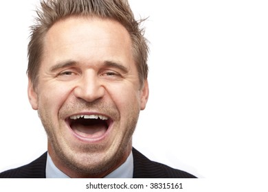 Closeup of businessman laughing into camera. Isolated on white background