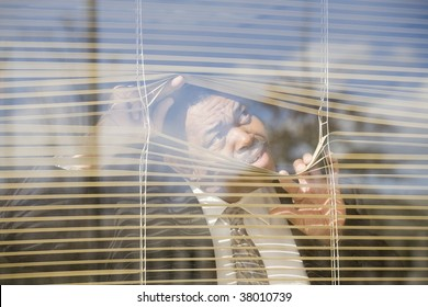 Close-up of a businessman looking through a window