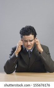 Close-up of a businessman looking upset