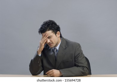 Close-up of businessman looking upset