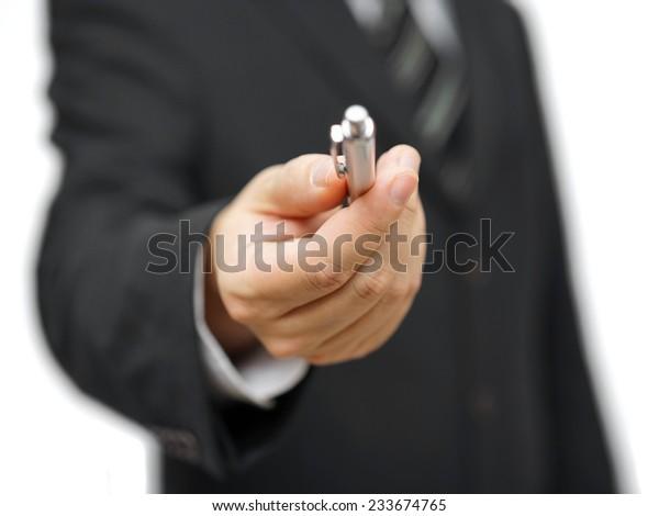 Closeup of businessman offering a pen