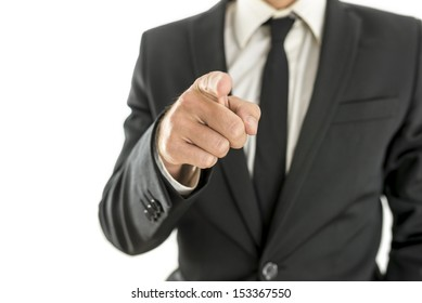 Closeup of businessman pointing finger at you. Isolated over white background.