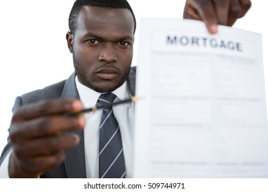 Close-up of businessman showing mortgage document