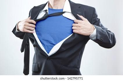 Closeup of a businessman showing the superhero suit under his shirt