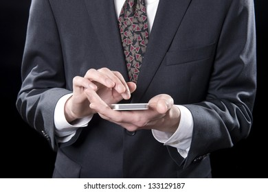 Closeup of businessman texting or emailing on cellular phone
