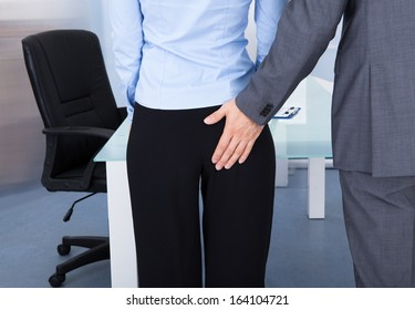 Close-up Of Businessman Touching Up Businesswoman's Buttock
