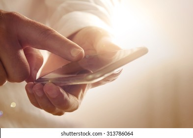 Closeup of businessman using modern smartphone. Image can be used for background, website banner, promotional materials, poster, presentation templates, advertising and printed materials.