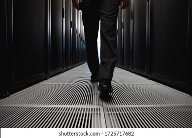 Close-up of businessman walking in server room in Cape Town, South Africa