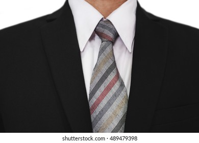 Close-up of businessman wearing black suit with a gray tie, white shirt