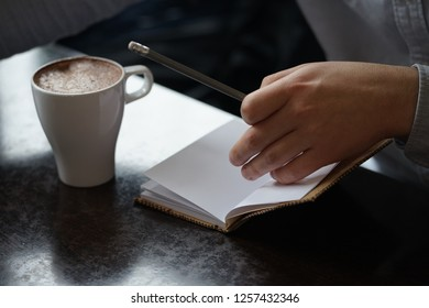 Close-up of a businessman working   in coffeehouse with coffee