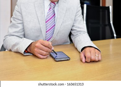 Close-up of a businessman working with a phablet as a concept of technology in business