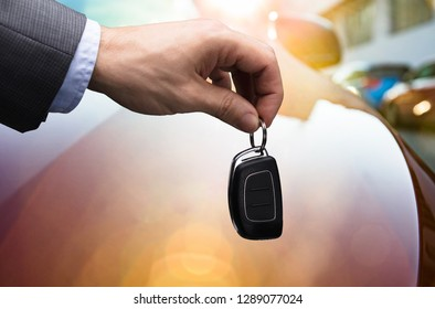 Close-up Of A Businessman's Hand Holding Car Key