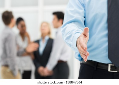 Closeup Of Businessman's Hand Ready for an Handshake to Seal a Deal