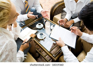 Close-up of businesspeople discussing a plan at meeting
