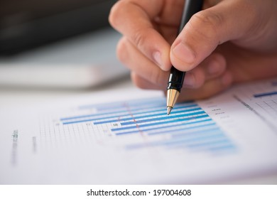 Close-up of businessperson working with statistics