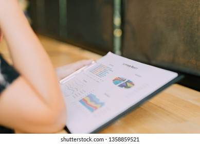 Close-up Of Businesswoman Analyzing Graph in the office - Image