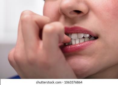 Close-up Of A Businesswoman Biting Her Fingernail