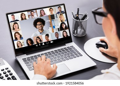 Nahaufnahme einer Geschäftsfrau, die Rechnungen auf Laptop im Büro berechnet