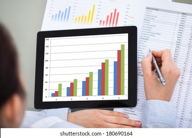 Close-up Of Businesswoman With Digital Tablet And Document