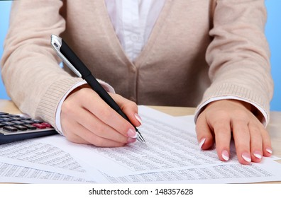 Closeup of businesswoman hands, working in office room