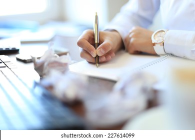 Close-up of Businesswoman makes a note at business document