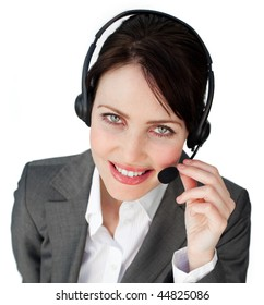 Close-up of a businesswoman talking on a headset against a white background