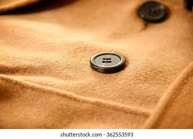 Close-up of buttons on wool coat.