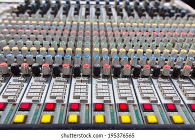 Closeup of buttons of a studio mixer.