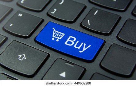 Close-up the Buy with Shopping Cart  symbol button on the keyboard and have Blue color button isolate black keyboard