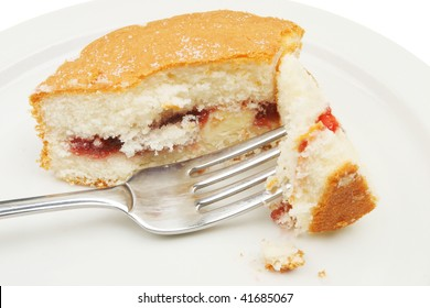 Closeup of cake with a fork on a white plate