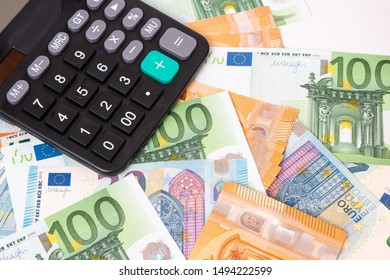 Close-up of calculator on Euro banknotes. Euro money bills to pay. Finances and budget concept. Tax and money.