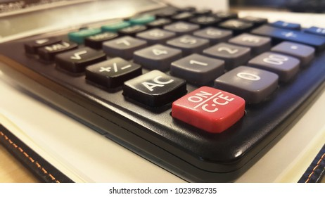 Close-up calculator on notebook