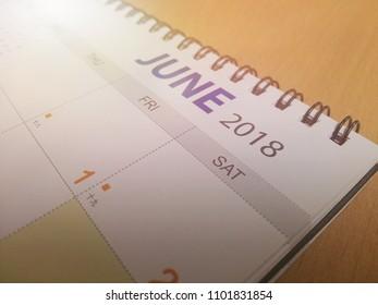 closeup of calendar focus on month JUNE 2018