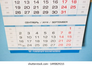 Close-up calendar for the month of September 2019. Hello September. Hello, Autumn. Russian-English calendar on a blue background