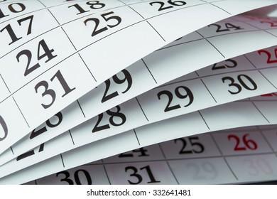 Closeup calendar page with drawing-pin