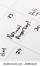 closeup of a calendar under march 23 with the words national, puppy day