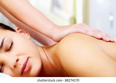 Close-up of calm female taking pleasure during massage