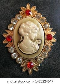 Closeup of cameo ornament on handbag