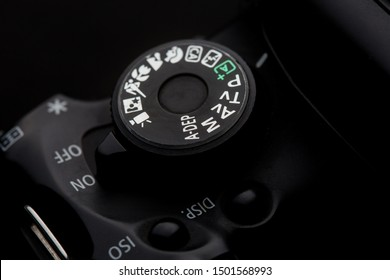 closeup of the Camera Modes wheel on a camera shot on a black background
