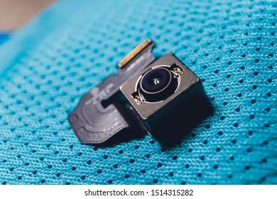 Close-up of camera sensor chip on cloth background.