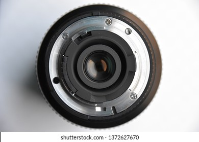 Closeup of a cameral lens on a white background