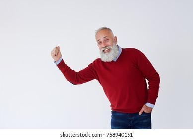 Closeup of candid bearded mature man raising hans and looking at camera
