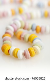 Closeup of a candy necklace, shallow depth of field.