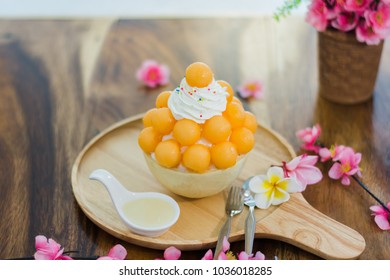 Closeup cantaloupe Bingsu on tray, Bingsu or Bingsoo, Korean shaved ice dessert with sweet toppings and fruit and varieties with ingredients,  popular dessert.